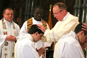 Fr. Henry Zinno is imposing his hands on Fr. Stephen Dandeneau, during his ordination in June 2011.