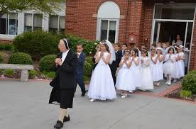 Our parish youth celebrate their First Communion in May each year.